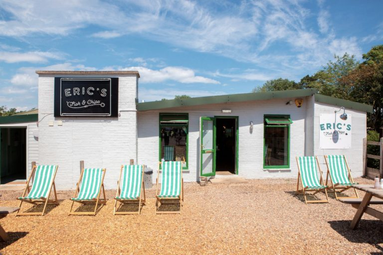 Outside Eric's Fish & Chips, a green and white colour scheme with striped deckchairs, a modern, funky fish and chip shop.
