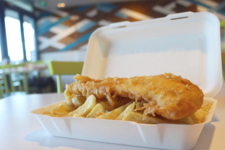 A portion of fish and chips in a takeaway polystyrene box at French's Fish Shop.