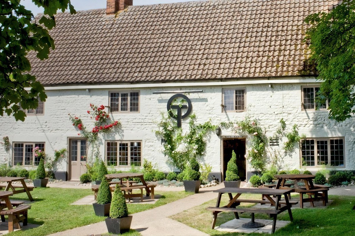 The Orange Tree country pub has roses climbing up the 400-year-old walls, with picnic benches and box topiary in the garden.