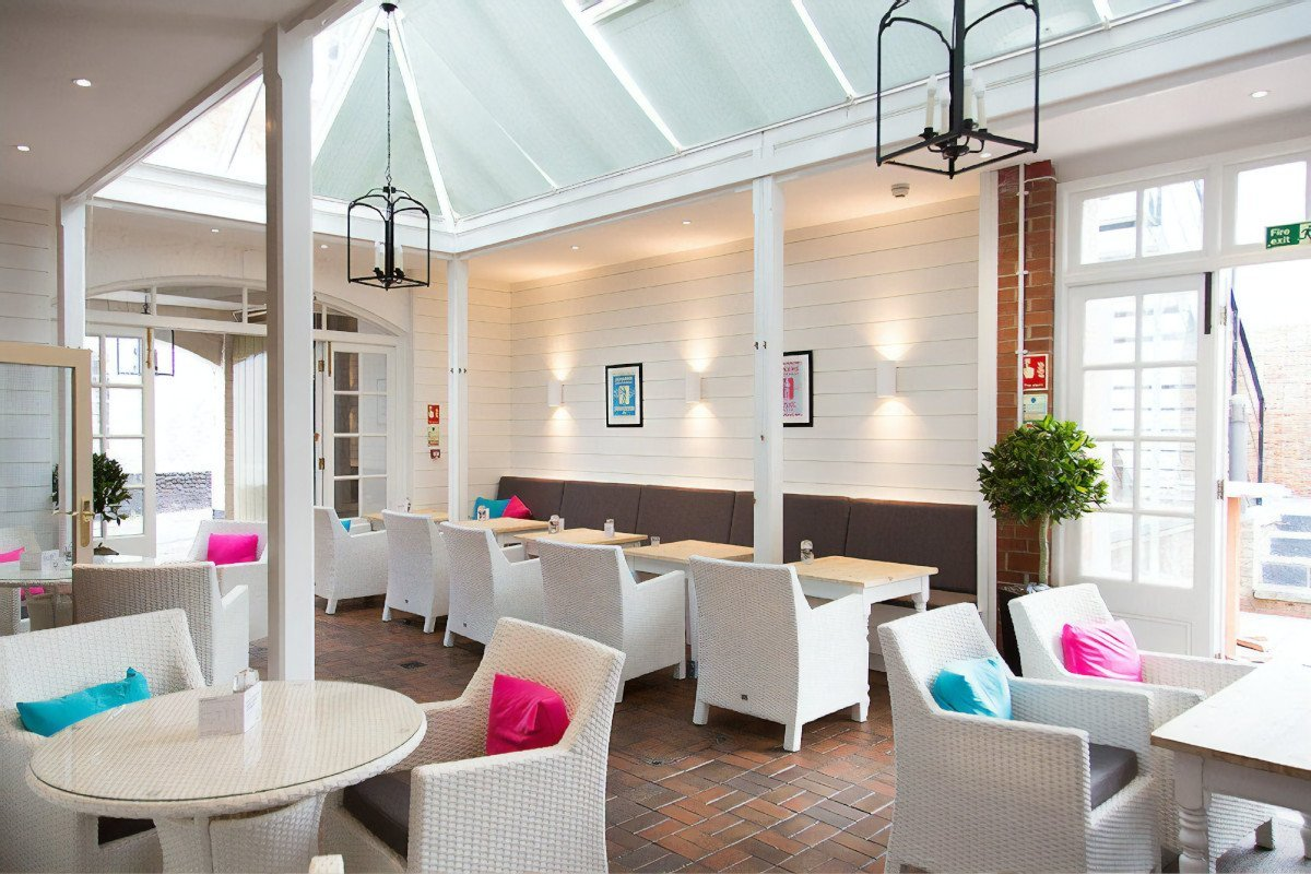 The White Horse lives up to its name, with white walls and white tables and chairs in the conservatory. Brightly coloured cushions complete the modern feel.