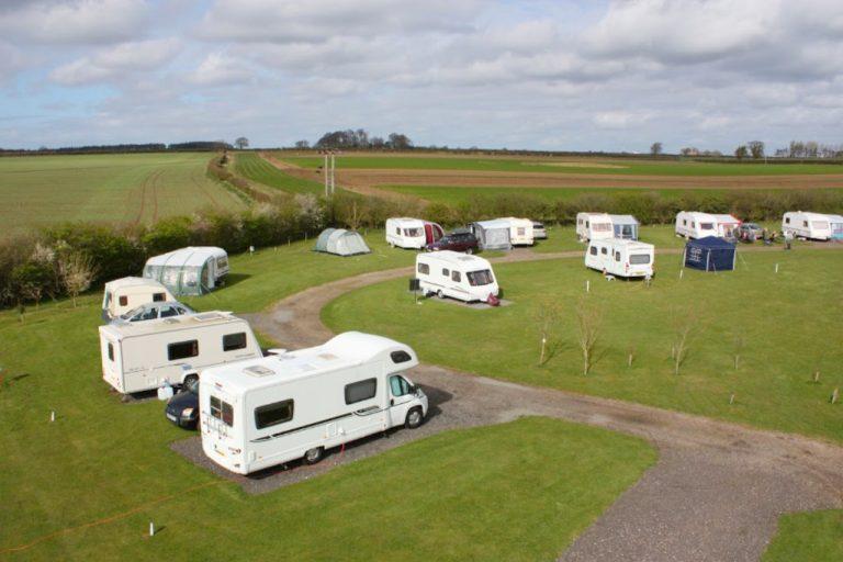 Fakenham Fairways campsite with caravans and motor homes.