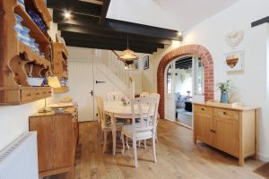 The dining room at Antwis Cottage holiday rental in Binham.