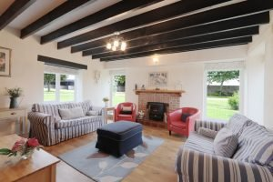 Lounge with oak beamed ceiling at Antwis Cottage, Binham.