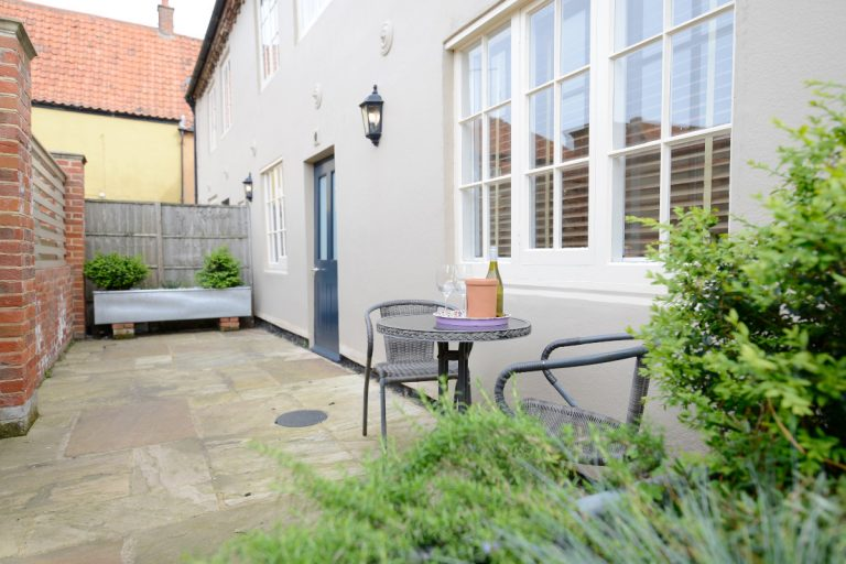 The exterior courtyard at Apartment One in Wells, Norfolk.