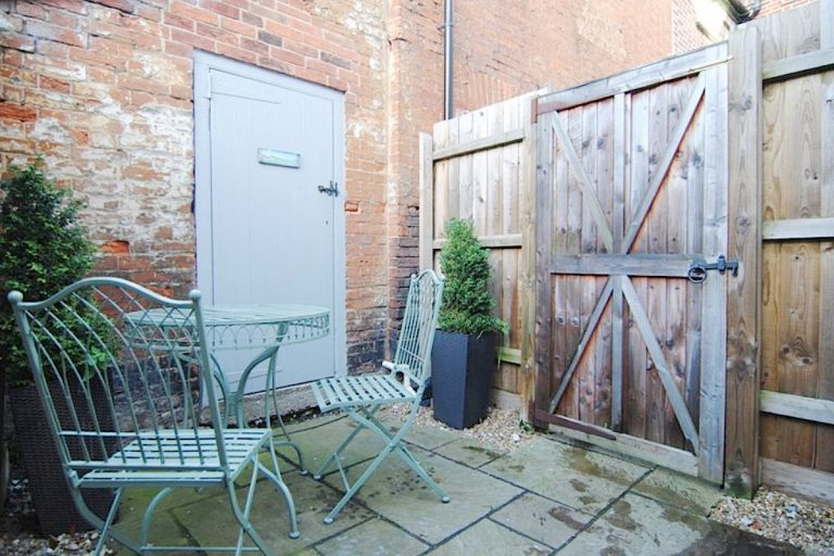 The enclosed courtyard at Elgin Cottage in Wells, Norfolk.