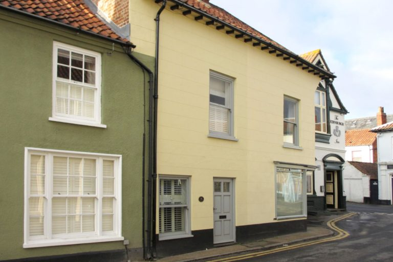 The yellow exterior of Elgin Cottage in Wells.