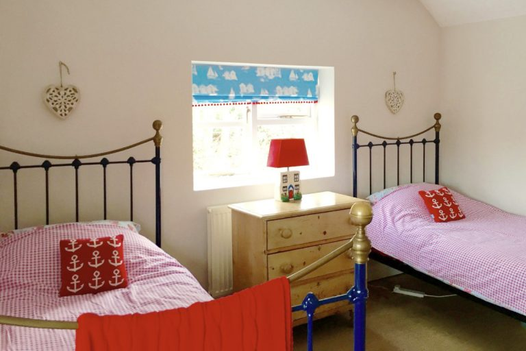 The colourful twin bedroom at Grey Seal Cottage in Wells.
