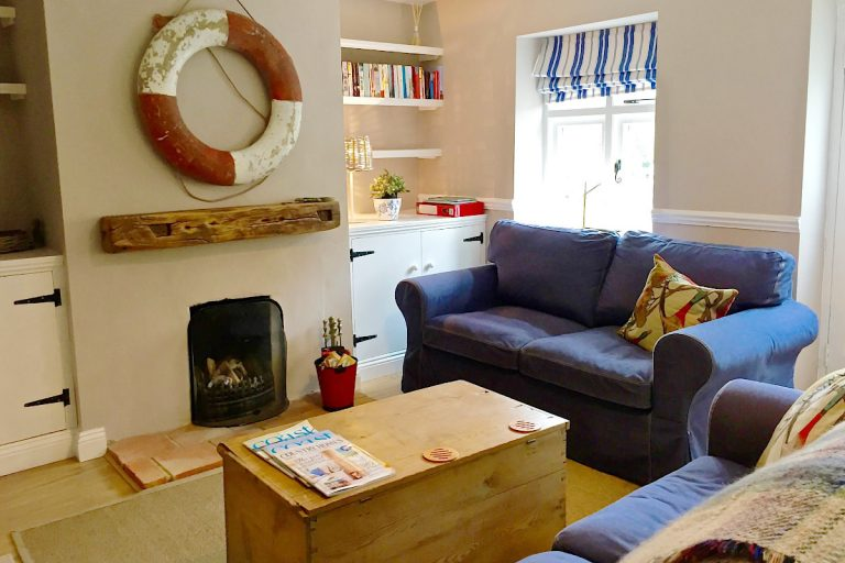 The coastal themed lounge at Grey Seal Cottage in Wells.
