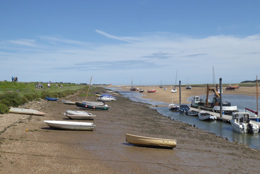 Boats in the harbour at low tide in Wells.