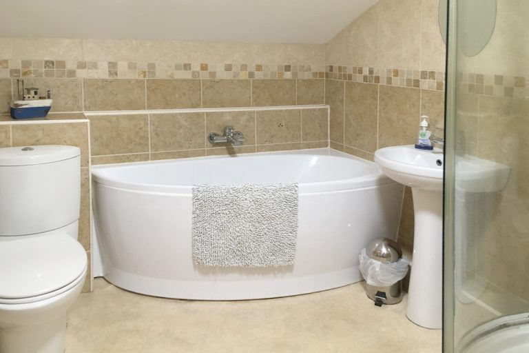 The bathroom in Hayloft Cottage, a holiday rental in North Norfolk