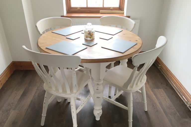 A dining room table with 4 chairs at Hayloft holiday rental in Wells