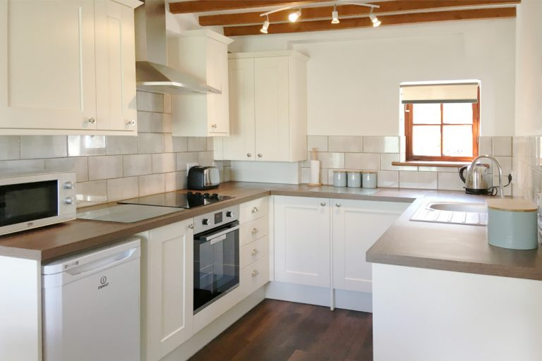 The modern kitchen at Hayloft holiday cottage in Wells