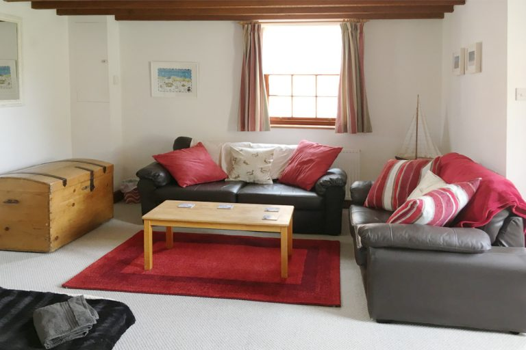 The lounge in Hayloft Cottage with two sofas and a coffee table