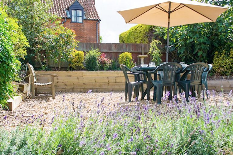 Lavender and outdoor furniture at Laylands Yard in Wells.