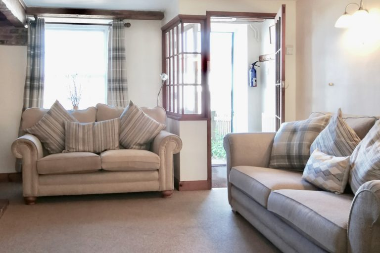 The lounge at Porthole Cottage in Wells-next-the-Sea.