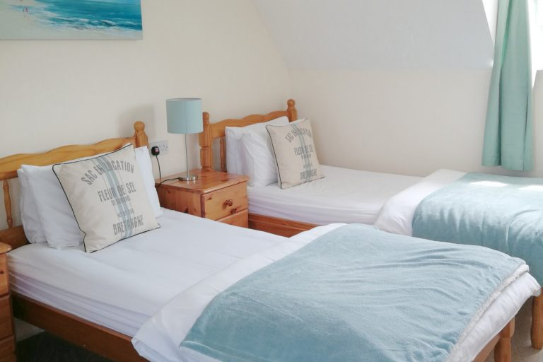 A twin bedroom at Porthole Cottage in Wells.