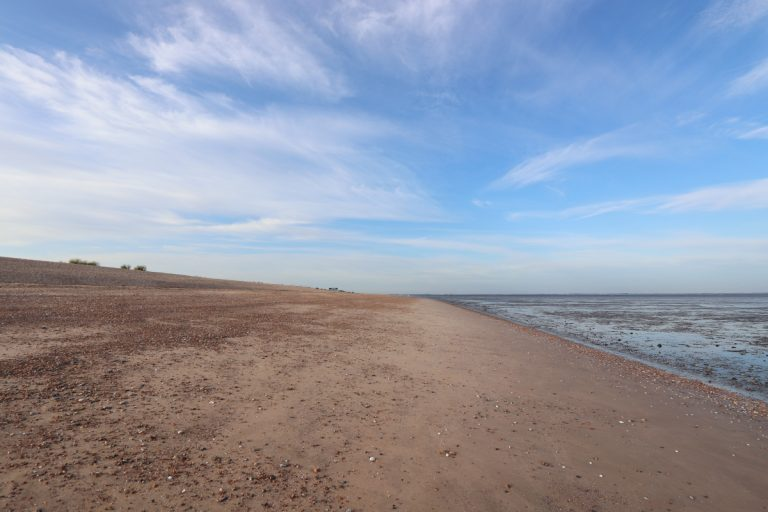 A vast empty beach under a big blue sky at Snettisham.
