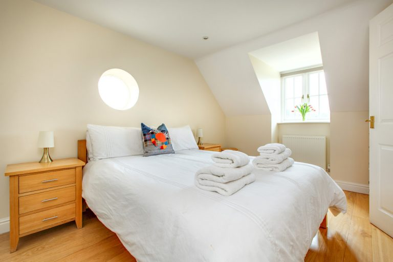 A light and airy double bedroom at Tolly House in Wells.