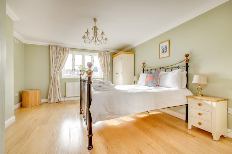 A spacious double bedroom at Tolly House in Wells, Norfolk.