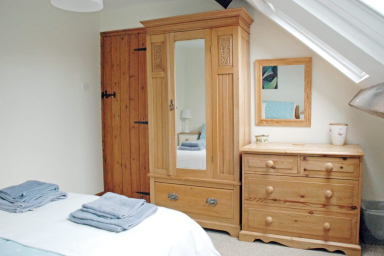 Wardrobe and chest of drawers in Barley Cottage double bedroom.