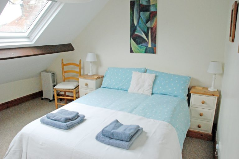 A double bedroom at Barley Cottage in Burnham Market.