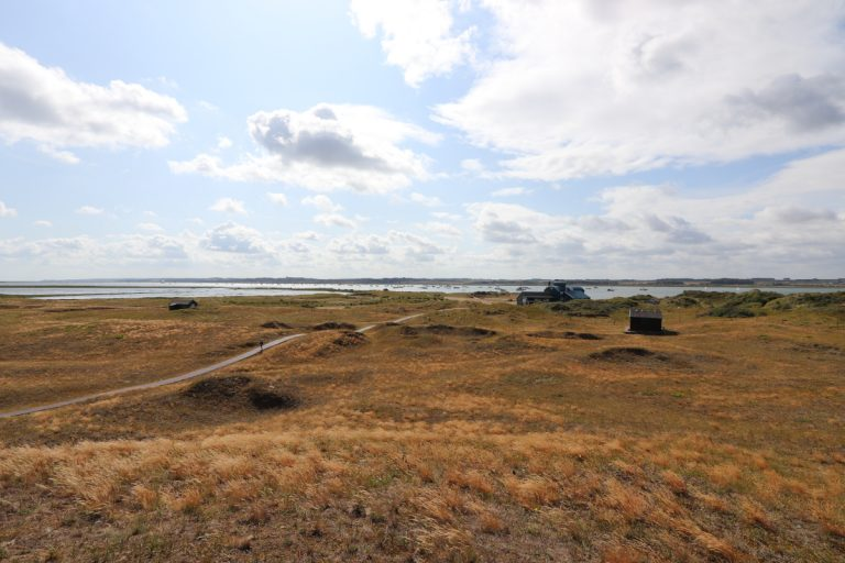 The Lifeboat House and wooden walkway from a distance at Blakeney Point.