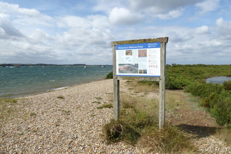 A National Trust information board on the landing beach at Blakeney Point.