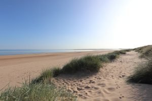 Sandy dunes and empty beach at Brancaster.