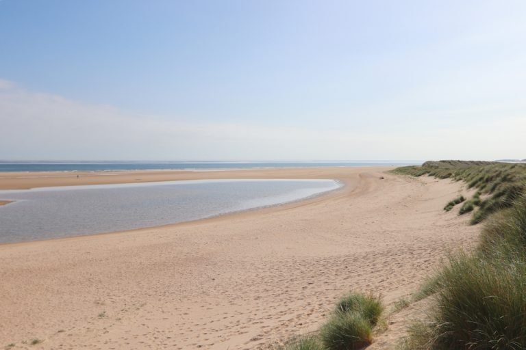 The sandy beach and shallows at Burnham Overy Staithe.
