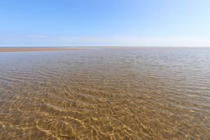 Crystal clear water at Burnham Overy Staithe beach.