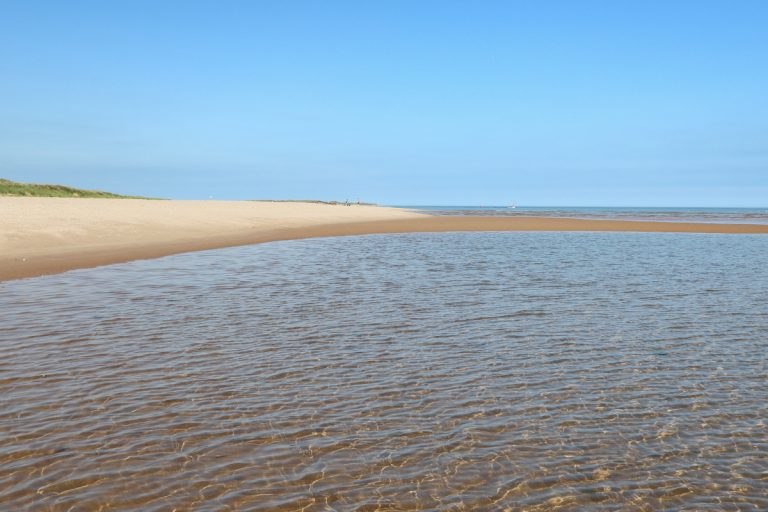 The beach and crystal clear water at Burnham Overy Staithe.