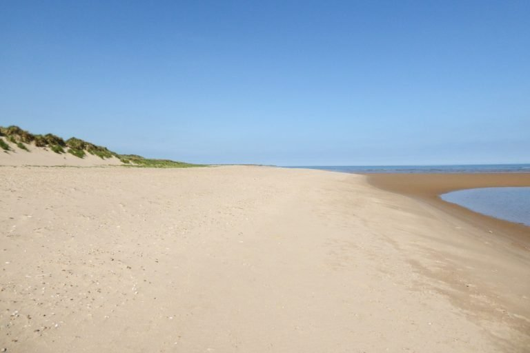 The empty sandy beach and dunes at Burnham Overy Staithe.