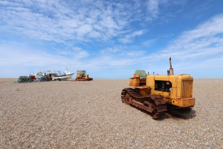Vehicles and fishing equipment on Cley beach.