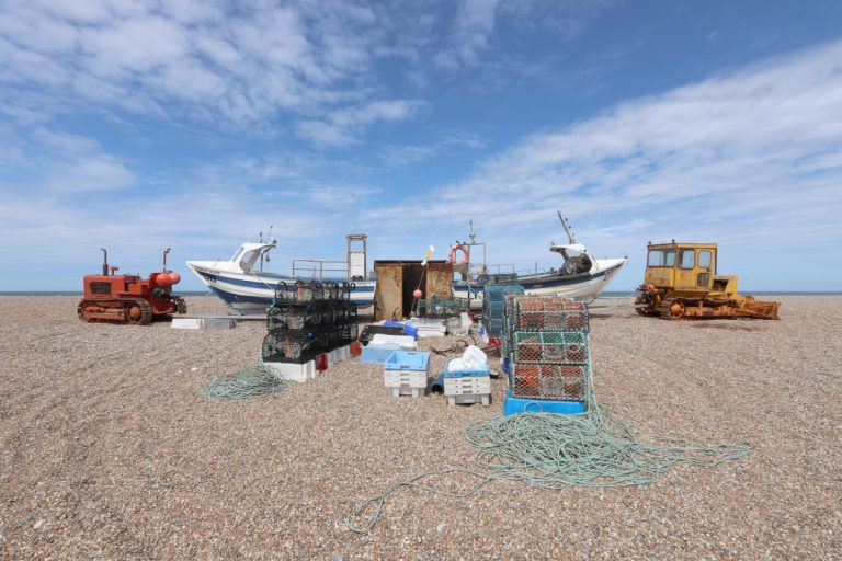 Boats and fishing equipment on the beach at Cley.