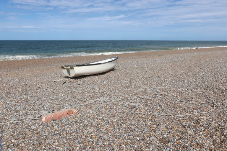A small boat and some rope on the beach at Cley.