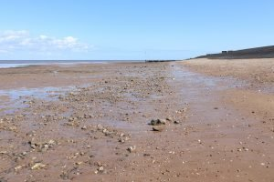 The empty beach at Heacham during low tide.