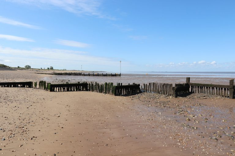 Wooden groynes at low tide on Heacham north beach.