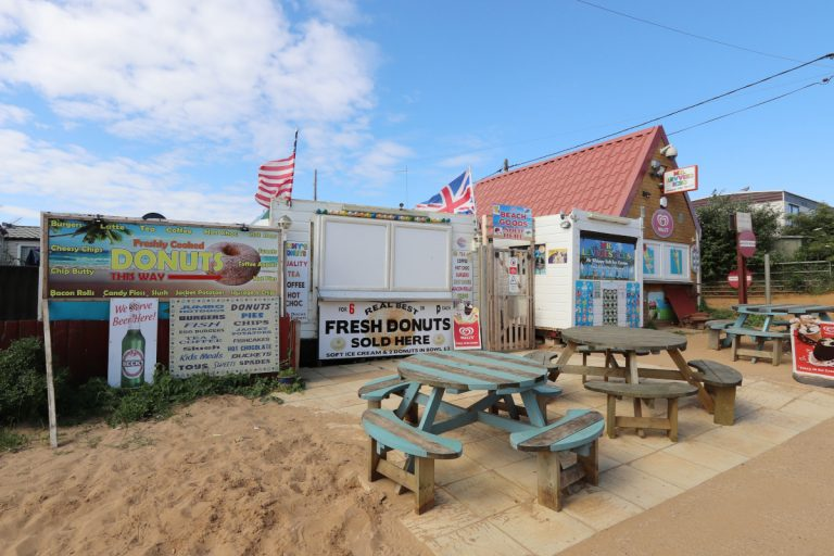 Food outlets and picnic benches near Heacham south beach.