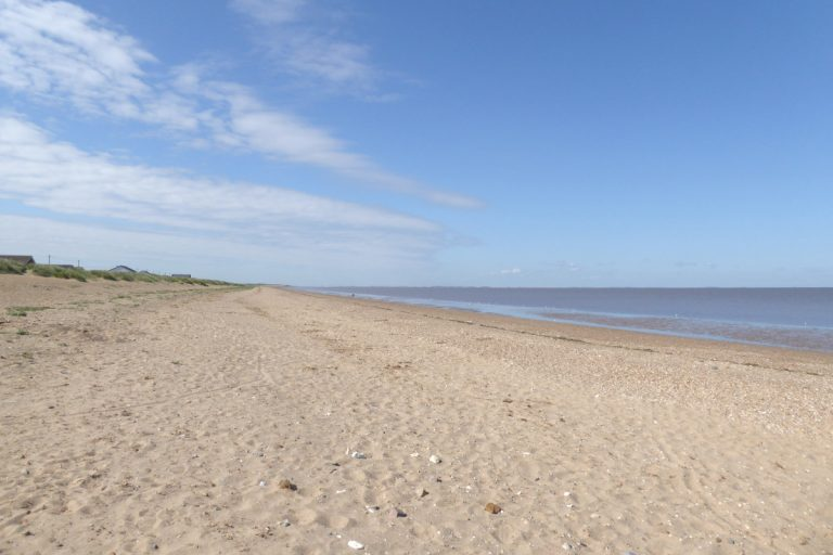 The empty sandy beach and dunes at Heacham.