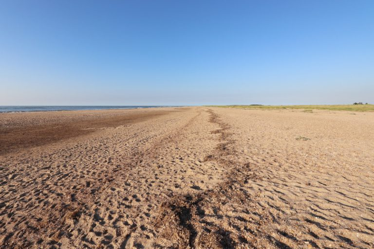 The empty beach at Holme on a sunny day,
