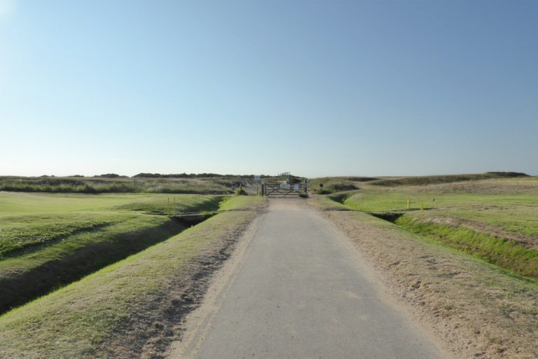 The entrance road and gated access to Holme beach.