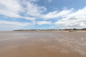 Distant view of Hunstanton from beach at low tide.