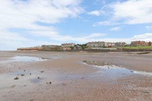 Hunstanton town and cliffs as seen from beach at low tide.