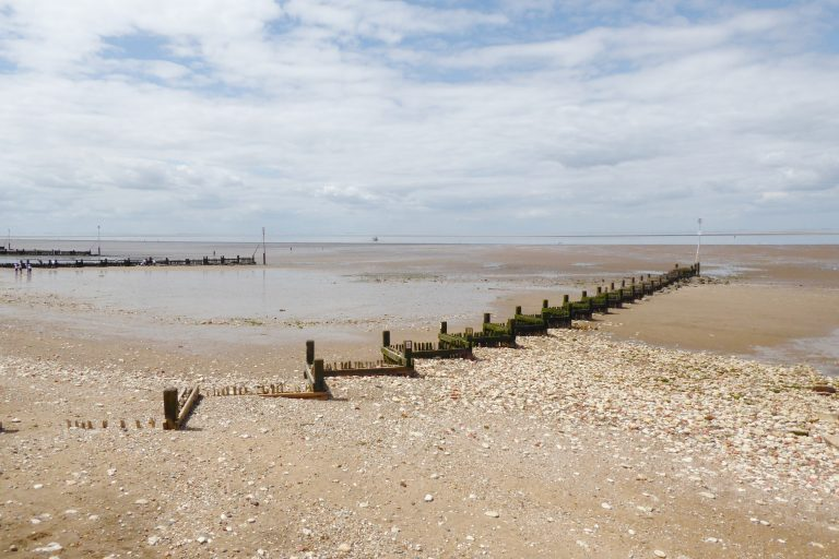 Wooden groynes in the sand at Hunstanton beach.