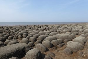 The large boulders on the beach at Hunstanton.
