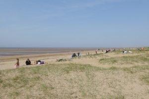 People enjoying the sandy north beach at Hunstanton.