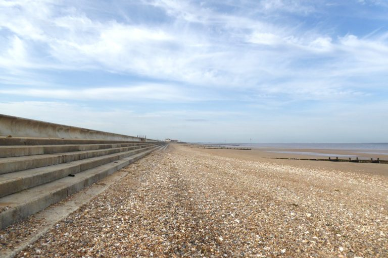 Concrete steps bordering the shingle beach at Hunstanton, Norfolk.