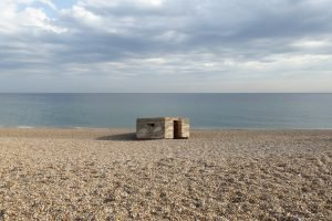 An old concrete military pillbox on Kelling beach.