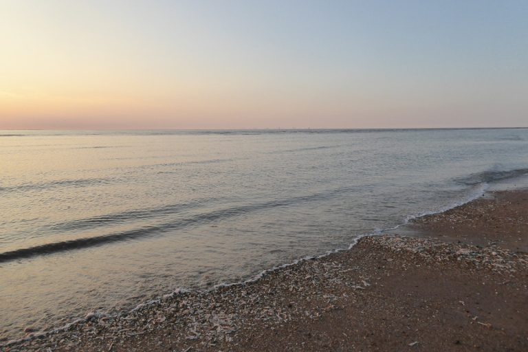 Sunset view over the water at Hunstanton beach.
