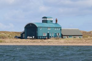 The Lifeboat House at Blakeney Point as seen from the water.